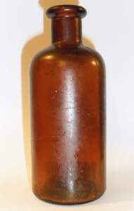 Amber utility bottle, marked FGW on base.