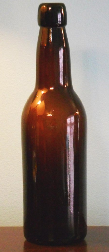 "Dark amber ""R & CO"" export beer bottle (mold number 49 on the base)."