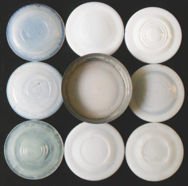 Group of Milkglass liners with various markings