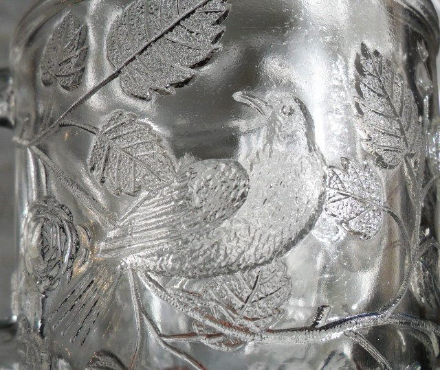 """Detail of bird design on """"Robin in a Tree"""" mug made by Bryce Bros. or U.S. Glass Company."""