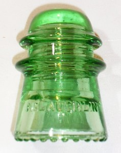 "CD 122 McLaughlin-16 ""toll"" insulator in a bright apple or lime green."