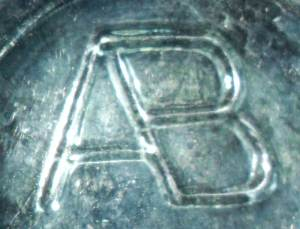 """AB-Connected""mark - on base of beer bottle."