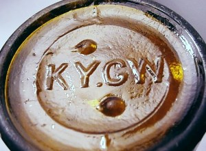 KY.G.W. mark on base of amber beer bottle.