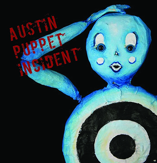 Bella the Target with Austin Puppet Incident written in red stencil