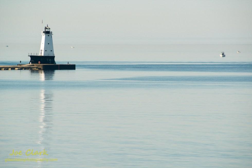 Ludington Lighthouse on a still morning by Joe Clark www.glasslakesphotography.com