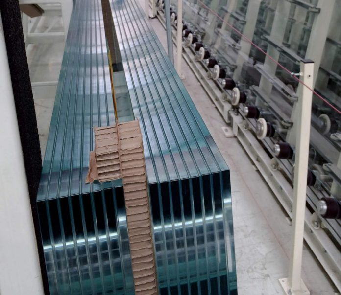 Two of the 8-ply laminated glass beams for supporting the roof glazing