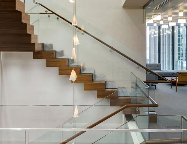 Floating Spiral Staircase with Glass Railing Increases Natural Light  SC Railing Company