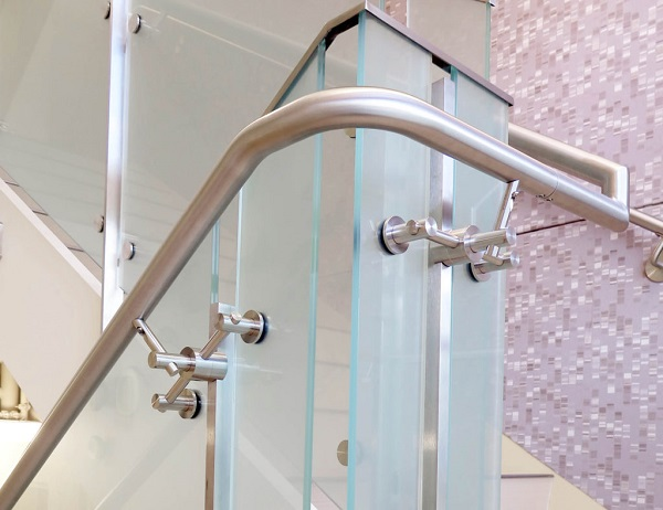 """The 1.5"""" stainless steel handrail is skillfully bent to achieve a fluid aesthetic around corners and other radius designs."""
