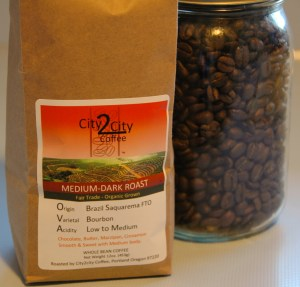 A photo of a one pound bag of coffee roasted by City2City Coffee in Portland. The coffee is a Brazil Saquarema.