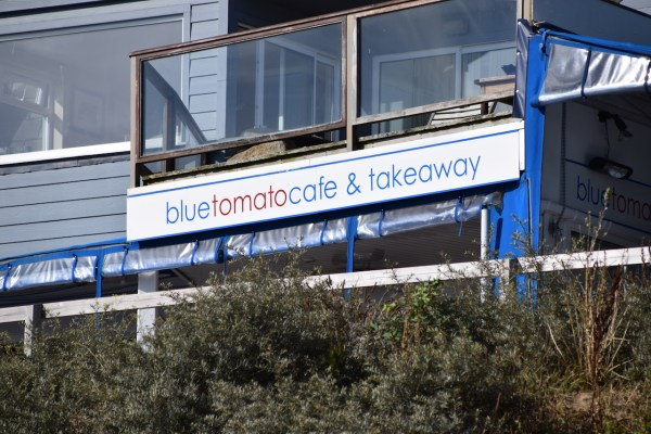 Sign Blue Tomato Cafe Rock Cornwall