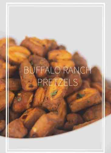 white bowl of buffalo sauce and ranch seasoned pretzel nuggets