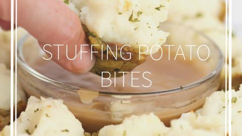 white plate with stuffing potato bbites with one dipping in gravy