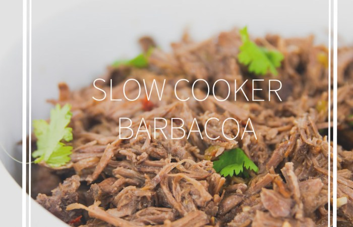 white bowl of shredded slow cooker beef barbacoa with cilantro with title