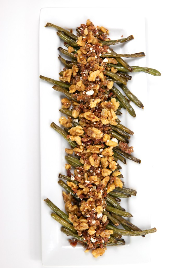 Green Beans with Bacon, Blue Cheese, and Walnuts overhead shot on a white rectangle plate