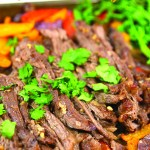 With these cilantro lime sheet pan fajitas you can make your entire dinner just on one pan. Juicy steak full of flavor you won't be disappointed. #fajitas #beef #beefdinner #dinner #sheetpandinner #onepandinner #mexicanfood #cilantro #cilantrolime #beefmarinade #easydinner #onions #peppers