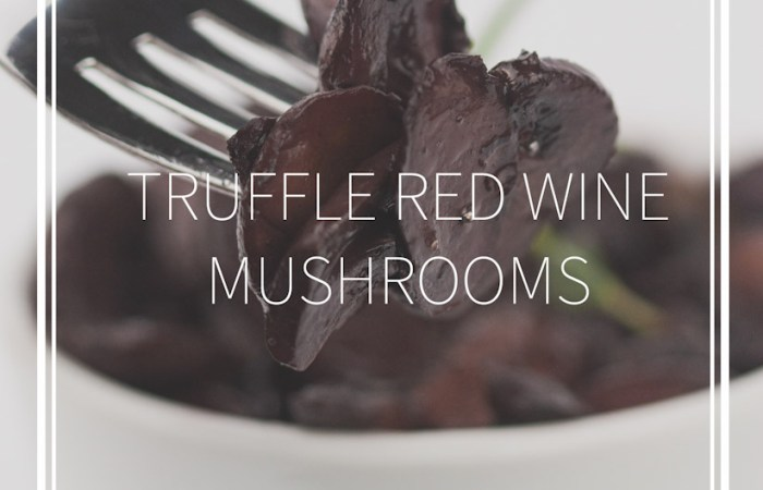 white bowl of sautéed truffle red wine mushrooms and a fork with the mushrooms on it
