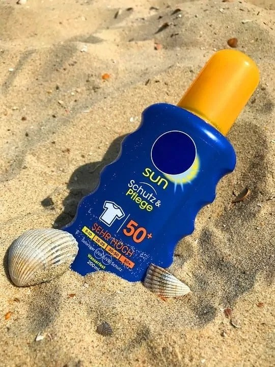travel essentials you need for the perfect trip abroad sun tan lotion