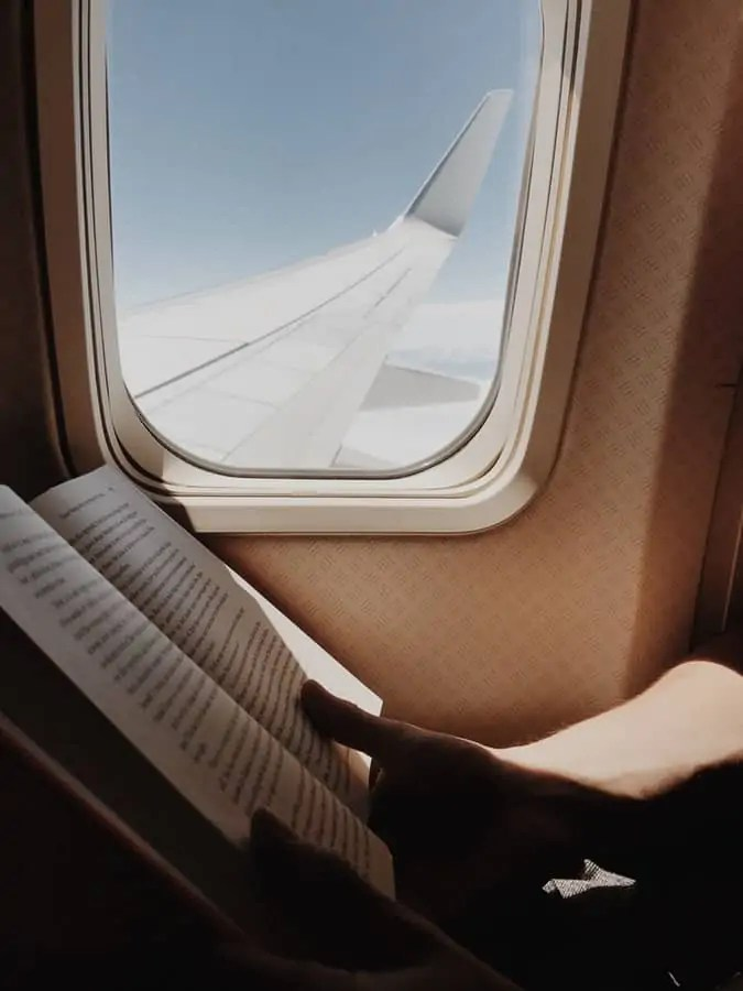 things to do on a plane read a book