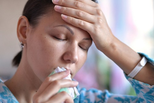 sick woman coughing