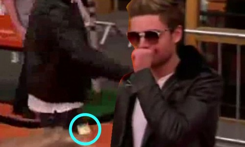 Zac Efron accidentally dropped a condom as went to take something out of his pocket when walking the red carpet at The Loraz premiere