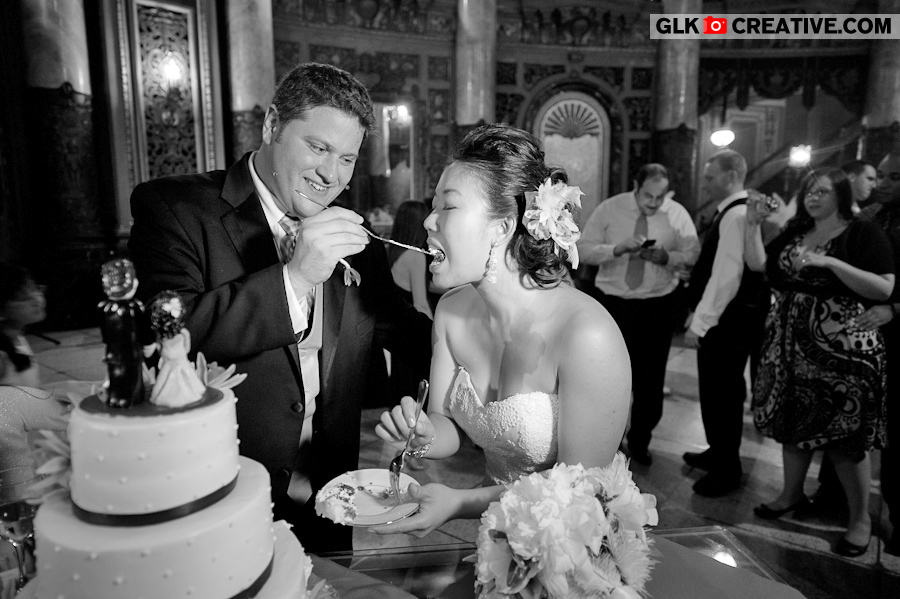 bride-groom-cutting-cake-at-landmark-loews-wedding