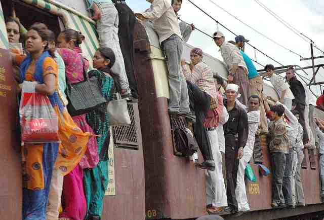 Local trains in Mumbai get very croweded at peak times but are the quickest way to get around the congested city.