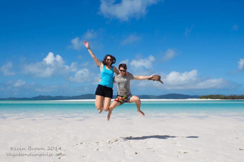 jumping for joy on whitehaven beach