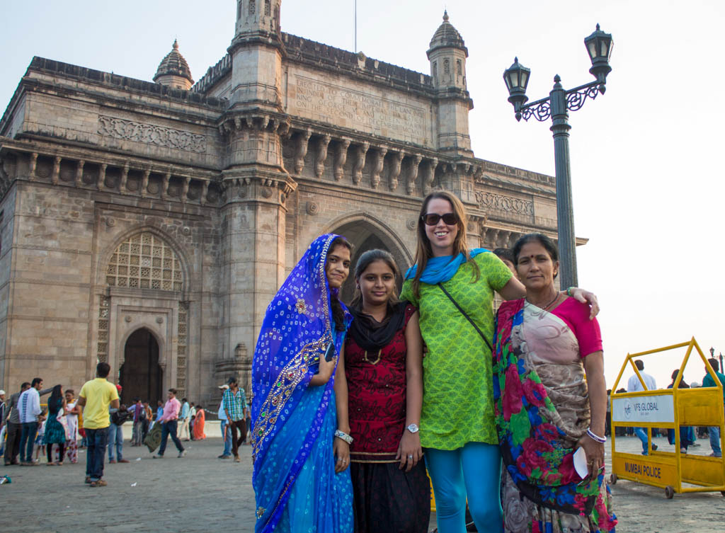 Making friends at the Gateway of India in Mumbai wearing Indian kurta, dupatta and churidar.