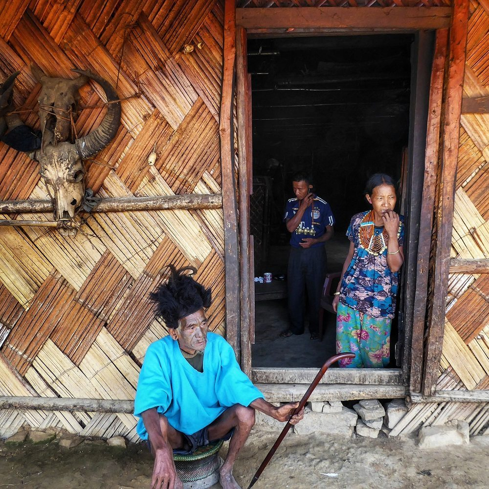 Konyak people outside their traditional houses