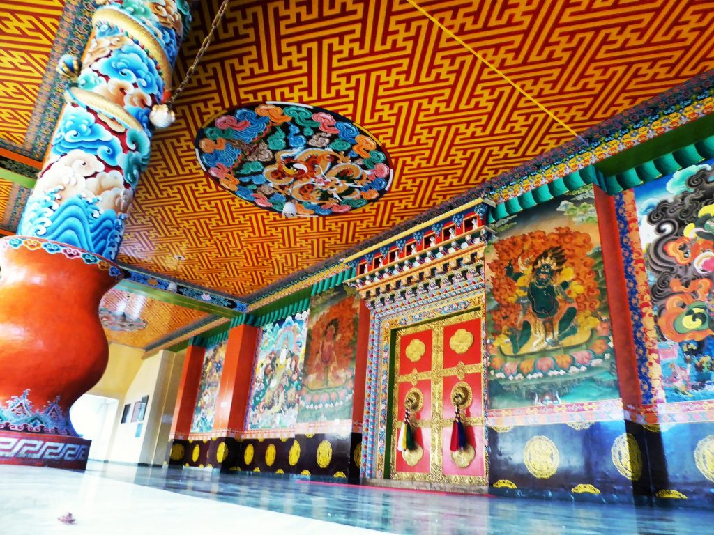 The incredible doors and elaborate details inside the Palpung Sherabling Monastery nestled in the forests outside Bir