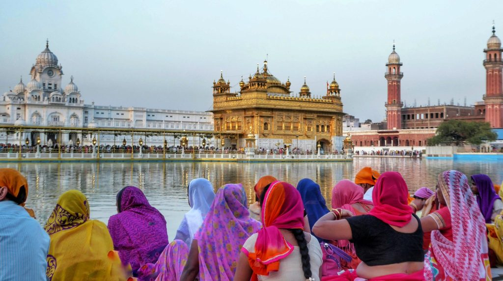 colourful pilgrims at the golden temple