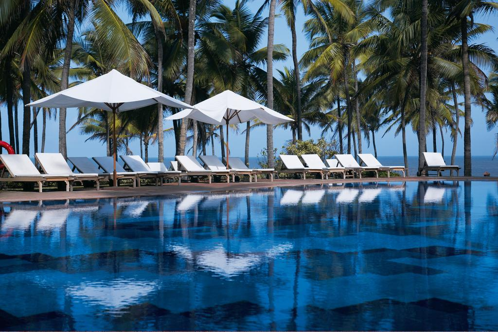 the pool at vivanta by taj holiday village one of the best luxury hotels in goa