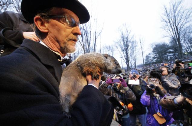 Groundhog Club handler Ron Ploucha holds Punxsutawney Phil during the 126th celebration of Groundhog Day on Gobbler's Knob in Punxsutawney, Pa. Photo Credit: Gene J. Puskar, AP