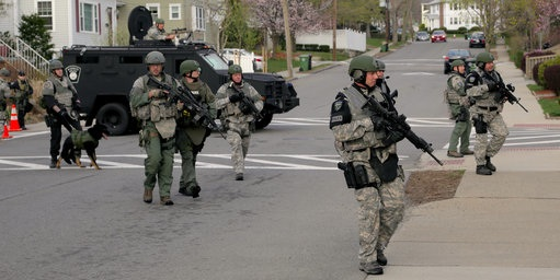 The police blocked off a 20-block residential area and urged residents to stay indoors. Photo Credit: NY Times