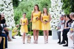 dog walking down the aisle with flower girls