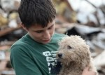 boy holds dog after oklahoma city tornado