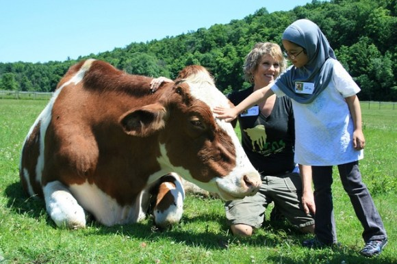 Kathy poses with Tucker and another student. Photo credit: Catskill Animal Sanctuary.