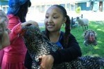 girl holds bird at catskill animal sanctuary