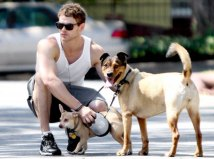 Though pictured above with his two dogs, Kellan Lutz recruits his twitter followers to join in the fight against cat declawing and support The Paw Project, a documentary that dispels the myths about this barbaric act. Photo Credit: Eonline.com