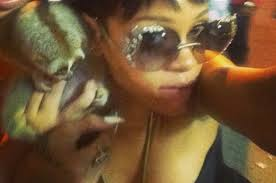 Rihanna poses with a slow loris in the streets of Thailand. This photo from her instagram account led to the arrest of 2 people allegedly peddling protected primates.