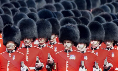 Scots guards on parade. Photograph: Dusan Vranic/AP