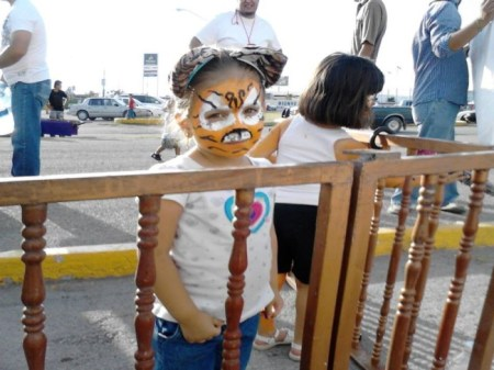 Young animal rights activist protesting outside a circus. Photo: Mari Robles