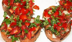 Bruschetta is an easy holiday appetizer, when topped with tomatoes and basil is the perfect vegan treat./Photo credit: savoring today.com
