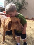 boy and dog, dogs, pets, puppies, puppy, adoption, adopted pets, dog adoption, Muttnation foundation