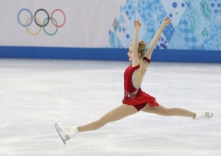 U.S. figure-skating champion Gracie Gold gives it her all in the women's short form program at the 2014 Winter Olympic.  Games./Photo credit: AP, Darron Cummings