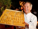 Master chef Puck displays a tray of miniature Oscar statues coated with 24k gold dust during the 86th Oscars Governors Ball press preview in Hollywood