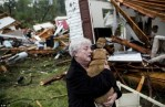 woman holds found dog after Mississippi tornado