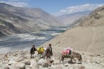 a couple villagers cross wakhan valley