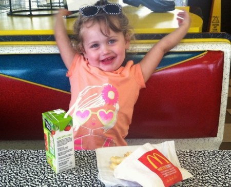 Three year old Jane Cohen at McDonalds enjoying her Happy Meal, something vegetarian and vegan children can't do./Photo credit: Lisa Singer