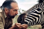Paul Mitchell poses with zebra